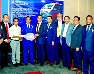 Mohammed Mahtabur Rahman, Chairman of NRB Bank Limited, handing over the key of an ambulance to the representatives of 'Amina Begum Memorial Hospital' in Aramnagar of Sarishabari in Jamalpur at the bank's head office in the city recently. Khandakar R Amin, Mohammed Jahed Iqbal, Aminur Rashid Khan, Md. Abdul Jalil Chowdhury, Md. Motior Rahman, Directors and Md. Mehmood Husain, CEO of the bank were also present.