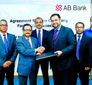 Sajjad Hussain, Managing Director (CC) of AB Bank Limited and Mostafa Kamal Ahmed, Head of Finance of Third Wave Technologies Limited (NAGAD), exchanging an agreement signing document at the Bank's head office in the city recently. Under the deal, the bank through its cash management service will facilitate the collections of NAGAD's nationwide distributors. Senior officials from both the organizations were also present.
