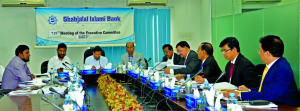 Akkas Uddin Mollah, Director of Shahjalal Islami Bank Limited, presiding over its 719th EC meeting at the bank head office in the city recently. Farman R Chowdhury, Managing Director, Engineer Md. Towhidur Rahman, Mohammed Younus, Khandaker Sakib Ahmed, Directors, M. Shahidul Islam, AMD and M Akhter Hossain, DMD of the bank were present.