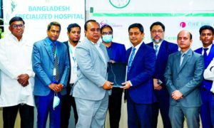 Al Emran Chowdhury, Director & CEO of Bangladesh Specialized Hospital Limited and Md. Kamruzzaman, Head of Retail Banking of ONE Bank Limited, exchanging document after signing an agreement at the bank's head office recently. Under the deal, Debit, Credit & Prepaid card holders of the bank with dependents will enjoy 25% discount on all Pathological test. High officials from both sides were present.