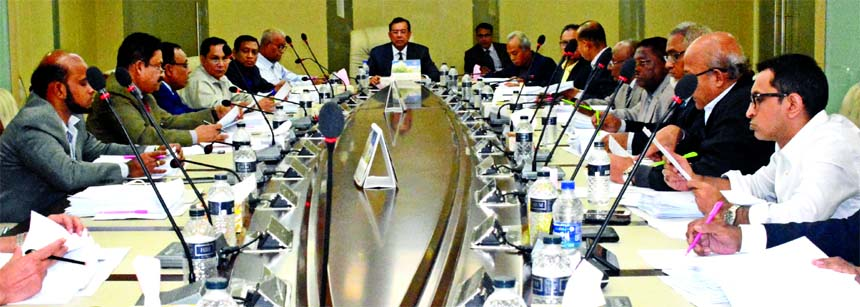 SM Amzad Hossain, Chairman, Board of Directors of South Bangla Agriculture & Commerce (SBAC) Bank Limited, presiding over its 70th meeting at the banks head office in the city on Monday. Md. Golam Faruque, Managing Director and Directors of the bank among others were present.