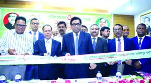 Md. Shaheb Ali Mridha, Director of BASIC Bank Limited, inaugurating its 70th branch at Jamalpur Sadar on Wednesday. Ahmed Hossain, Managing Director (Additional Charge), top executives and officials of the bank and local businessmen were also present.