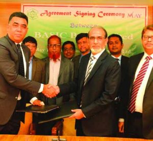 Md. Rafiqul Alam, Managing Director of BASIC Bank Limited and Syed Aminul Kabir, CEO of May International Trade Services Limited, exchanging signing document at the bank's head office in the city on Tuesday. Senior officials from both institutions were present.