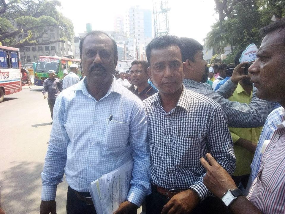 Employees of Bangladesh Palli Unnayan Board (BRDB) holds human chain and rally in the capital