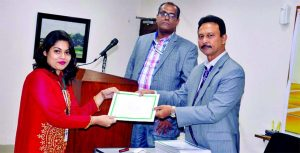 "ASM Bulbul, Deputy Managing Director of National Bank Limited, handing over a certificate to a participants of a 10 day-long course on ""Credit Operation & Risk Management"" (19th Batch) at its head office recently. Vice President and Principal (C.C.) Shah Syed Rafiul Bari was also present."