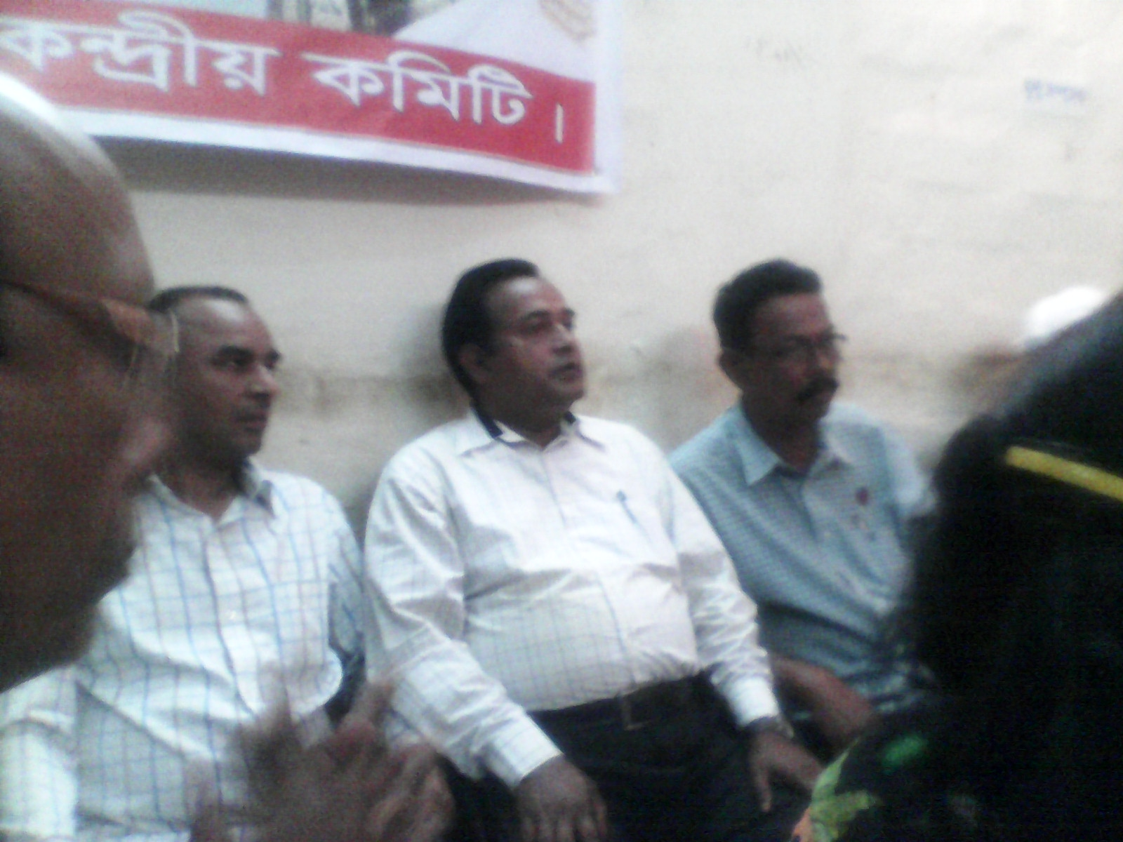 Mahmudul Hoque Khan Dulal is seen along with others