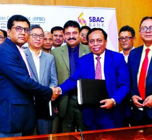 Md. Golam Faruque, Managing Director of South Bangla Agriculture and Commerce (SBAC) Bank Limited Bank and Md. Asaduzzaman, Company Secretary of Dhaka Power Distribution Company (DPDC) Limited, shaking hands after signing an agreement at the DPDC's conference room in the city on Monday. DPDC 's Managing Director Engineer Bikash Dewan, Bank's AMD Mostafa Jalal Uddin Ahmed, DMD Md. Mamunur Rashid Molla, DPDC Executive Directors Jayonta Kumar Shikdar, Md. Golam Mostafa, ATM Harun-Or-Rashid and ASM Shahidul Islam were also present.