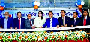 ASM Feroz Alam, Chairman of Premier Leasing Securities Limited, inaugurating its new branch at Sadar Road in Barishal on Wednesday. Md. Nasiruddin Choudhury, Vice-Chairman, Engr. AZM Akramul Haq, EC Chairman, Abdul Hamid Mia, Managing Director, Sufior Rahman Chowdhury, Independent Director of the company and local elites were also present.