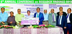 Md. Abdul Halim Chowdhury, Managing Director of Pubali Bank Ltd, handing over a cheque of Tk 15 lakh to Professor Farid Uddin Ahmed, Vice Chancellor of Shahjalal University of Science and Technology (SUST) Research Centre as a part of Corporate Social Responsibility recently. Director of SUST Research Centre Professor Dr. Md. Zakir Hossain presided over the function.