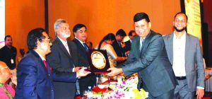 Rajesh Surana, CEO of LafargeHolcim Bangladesh, receiving the Highest Taxpayer Award in the cement manufacturing category in 2017-18 from the State Minister for Finance and Planning M A Mannan at Sonargaon Hotel in the city recently. Md. Mosharraf Hossain Bhuiyan, NBR Chairman and Iqbal Chowdhury, CFO of the company were also present.