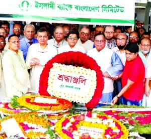 Arastoo Khan, Chairman of Islami Bank Bangladesh Limited, paying tribute by placing wreath to the portrait of Bangabandhu Sheikh Mujibur Rahman marking his birth day on Saturday at 32 No. Road, Dhanmondi. Major Gen. (Retd.) Engr. Abdul Matin, EC Chairman, Dr. Md. Zillur Rahman, Audit Committee Chairman, Helal Ahmed Chowdhury, Risk Management Committee Chairman, Md. Joynal Abedin, Md. Mizanur Rahman, Professor Dr. Kazi Shahidul Alam Directors and Muhammed Munirul Moula, Managing Director (CC) of the bank among others were also present.