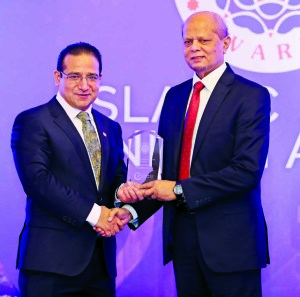 Md. Abdul Hamid Miah, Managing Director of Islami Bank Bangladesh Limited, receiving the 'Islamic Retail Banking Awards (IRBA) 2017' from Professor Humayon Dar, Chairman and Founder of IRBA on Tuesday at JW Marriott Marquis Hotel in Dubai. The bank achieved the award for strongest Islamic retail bank in South Asian Region conferred by UK-based financial intelligence house Cambridge IF Analytica.
