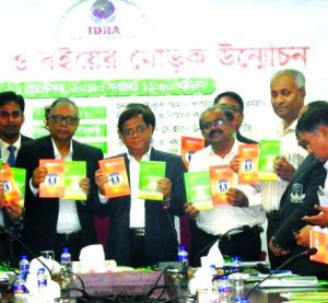Md Shafiqur Rahman Patwary, Chairman of the Insurance Development and Regulatory Authority (IDRA), unveiling two books 'Jibon Bima' 'Sadharan Bima' published by Corporate Training Institute Expert Academy at IDRA auditorium in the city on Monday. Dr Mohammad Sohrab Uddin, Actuary of IDRA and other distinguesh from different sector were also present.