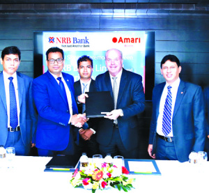 Imran Ahmed FCA, Chief Operating Officer of NRB Bank Limited and Kelly Lewis, General Manager of Amari Dhaka, exchanging an agreement signing documents at the hotel in the city recently. Under the deal, Credit Cardholders of the bank will be privileged with Buy 1 Get 1 Free iftar dinner buffet during Ramzan whereas Credit Cardholders will enjoy 2 Iftar Dinner buffet at the cost of one. Senior officials from both the organizations were also present.