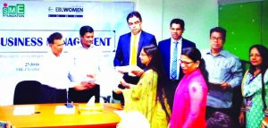 """Jiban Krishno Roy, General Manager, Sylhet Office of Bangladesh Bank, handing over the certificates to the participants of the """"SME Business Management Training for Women Entrepreneurs"""" jointly organized by Eastern Bank Limited with SME Foundation at a auditorium in Sylhet recently. Masudur Rahman, Manager, Women Entrepreneur Development Wing of SME Foundation and Oli Ahad Chowdhury, Head of Assets, Consumer and Business of the Bank among others were also present."""
