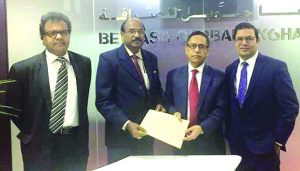 Kazi Towhidul Alam, AMD of Social Islami Bank Ltd (SIBL) and Sajeev Kumar R, General Manager of Belhasa Golabal Exchange (a UAE based global money exchange company), exchanging an agreement signing document to facilitate the inward remittance at the Corporate Head Quarter of Belhasa Group, Al-Qusais in Dubai recently. Senior official from both the organizations were also present.