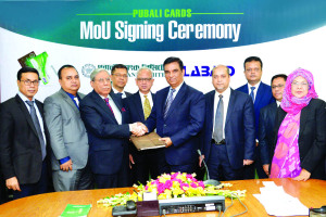 A MoU signing between Pubali Bank Limited and LabAid Ltd. was held at bank's head office on Wednesday. Md. Abdul Halim Chowdhury, Managing Director of the bank and Advisor, Admin of LabAid Ltd. Brig. Gen. (Dr.) Manzoor A. Mollah (Retd.) were also present among others. Under this deal, the bank's Credit and Debit Card holders will avail 10 pc discounts on various diagnostic tests of the hospital.