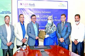 Mamoon Mahmood Shah, MD and CEO of NRB Bank Ltd and Nasreen Jahan Ratna, MP, Chairman of Kuakata Grand Hotel and Sea Resort seen exchanging documents after signing an agreement on Nov 11 at the former's head office in the capital. Under which, cardholders of the bank will get discounts at the hotel on its services