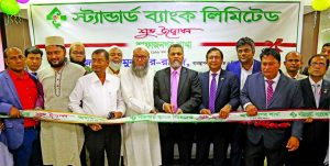 Mamun-Ur-Rashid, Managing Director of Standard Bank Limited, inaugurating its 126th branch at Afaznagar Residential Area in Fatullah in Narayanganj on Thursday. Md. Tariqul Azam, AMD, Syed Monsoor Ali, Vice-President and other senior officials of the Bank and local elites were also present.