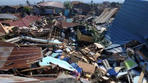 Mass burials as death toll in Indonesia quake-tsunami tops 800