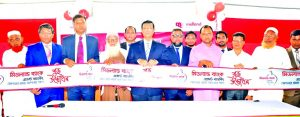 Md. Ahsan-uz Zaman, CEO of Midland Bank Limited, inaugurating an Agent Banking Centre at Oddirgola Bazar in Shabgram Union of Bogura Sadar recently. Md. Ridwanul Haque, Head of Retail Distributions and Agent Banking Division of the Bank and local businesses were also present.