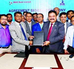 Mostafa Jalal Uddin Ahmed, Additional Managing Director of South Bangla Agriculture and Commerce (SBAC) Bank and ANM Tajul Islam, GM and Head of Marketing of Ibn Sina Trust, exchanging documents after signing an MOU at the Bank's head office recently.