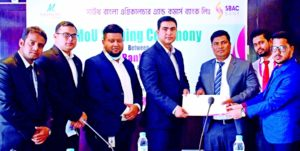 Mohammad Shafiul Azam, Head of Card Division of South Bangla Agriculture and Commerce (SBAC) Bank Limited and Gazi K. Rahman, GM of Momo Inn Hotel & Resort, Bogura, exchanging document after signing an agreement at the resort recently. Under the deal, debit-credit cardholders and employees of the bank will get up-to 40 percent discount of different services in the resort. Tariqul Islam Chowdhury, CEO of the bank and senior officials from both sides were present.