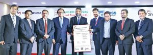 Anis A Khan, CEO of Mutual Trust Bank, receives the Payment Card Industry Data Security Standard certification from Bharat Malik, a representative of SISA Information Security, at a ceremony at MTB Tower in Dhaka recently. Photo: Mutual Trust Bank