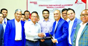 Nasir Uddin, Managing Director of Pacific Casuals Limited and Mahbubur Rahman, DMD of City Bank Limited, exchanging a strategic agreement signing document at Pacific Jeans head office at CEPZ in Chattogram on Wednesday. Other senior officials from both sides were also present.
