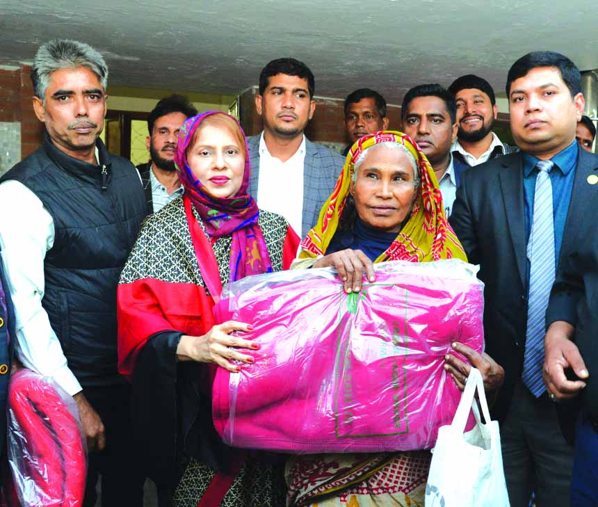 Parveen Haque Sikder, M.P, Director along with Zainul Haque Sikder, Chairman and Monowara Sikder, Director of National Bank Limited, distributing blankets to the poor distressed people on the occasion of the death anniversary of late Mokfor Uddin Sikder, father of Zainul Haque Sikder at the premises of Z.H. Sikder University of Science & Technology in Bhedergonj in Shariatpur on Wednesday.