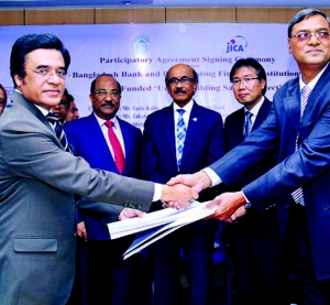 Swapan Kumar Roy, General Manager, SMESPD of Bangladesh Bank (BB) and A K M Shahidul Haque, Managing Director and Chief Executive Officer (CEO) of Islamic Finance and Investment Limited (IFIL), exchanged documents of a Participatory Agreement 'UBSP' funded by JICA at Bangladesh Bank headquarters on Monday. Fazle Kabir, Governor, BB and Takatoshi Nishikata, Chief Representative, JICA Bangladesh Office were present at the signing ceremony among others.