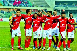 Players of Bashundhara Kings celebrating after defeating Bangladesh Police by three goals to nil in their semi-final match of the Federation Cup Football at the Bangabandhu National Stadium on Friday.