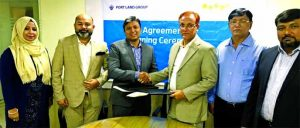 Mohammad Mobydur Rahman, Head of B2B, Partnership & Loyalty of Tonic (a digital healthcare service) and Md. Mizanur Rahman Mazumder, Managing Director of Port Land Group Limited, exchanging document after signing an agreement at Portland Sattar Tower in Chattogram recently. Under the deal, Port Land Group's employees will have the opportunity to enjoy various benefits from Tonic. Top officials from both sides were also present.