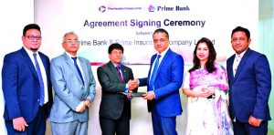 ANM Mahfuz, Head of Consumer Banking of Prime Bank and Sujit Kumar Bhowmik, AMD of Prime Insurance Company Limited, exchanging an agreement signing documents at the Bank's head office in the city recently. Under the deal, Monarch Customers of the Bank will enjoy complimentary Overseas Travel Insurance Facility. Senior officials from both the organizations were also present.