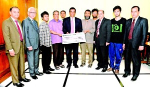 Md Abdul Halim Chowdhury, Managing Director of Pubali Bank Ltd, handing over a Tk 5.00 lakh cheque to Professor Dr. M. Sohel Rahman, Head of CSE Dept, BUET as part of Corporate Social Responsibility recently. Professor Dr. M. Kaykobad, Dean, Faculty of Electrical & Electronic Engineering of BUET; Safiul Alam Khan Chowdhury, Additional Managing Director of the bank were also present.