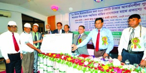 Abu Hena Mohd. Razee Hassan, Deputy Governor of Bangladesh Bank, handing over chaque of a 'Open loan disbursement in Dinajpur to 10 taka account-holders' organized by National Bank Limited (NBL) at a local auditorium recently as chief guest. MA Wadud, AMD of NBL, Joarder Israil Hossain, Executive Director of Central Bank of Rangpur Office and Md. Ali Mortuza, General Manager of Sonali Bank Ltd were also present. NBL was the lead bank in the programme.