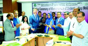 Professor Dr. Rubina Hamid, First Vice-President of Bangladesh Insurance Association (BIA) and Dirk Reinhard, Vice-Chairman of Munich Re Foundation (a German based NGO), exchanging a MoU signing document will be held at the 15th International Micro Insurance Conference at BIA office in the city recently. Top officials from both the organizations were also present.