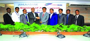 AKM Saifuddin Ahamed, DMD, Jamuna Bank Limited and Sohail Majid, Deputy Director (Marketing & Sales) of US-Bangla Airlines Ltd, exchanging an agreement signing documents at the bank's head office in the city recently. Under the deal, employees and credit card holders of the bank will get installment and corporate facilities from the airlines. High officials from both the organizations were also present.
