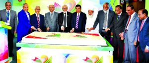 Professor Md. Anwarul Azim Arif, Chairman, Board of Directors of Social Islami Bank Limited, inaugurating its 24th anniversary programme by cutting a cake at the bank's corporate office in the city on Sunday. Md. Sayedur Rahman, Vice-Chairman, M. Kamal Uddin, Dr. Md. Jahangir Hossain, Directors and Quazi Osman Ali, CEO of the bank were also present.