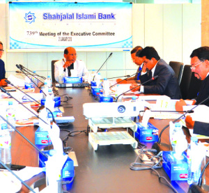 Engineer Md. Towhidur Rahman, EC Member of Shahjalal Islami Bank Limited, presiding over its 739th meeting at its head office in the city recently. Akkas Uddin Mollah, Chairman of the Board of Directors, Farman R Chowdhury, Managing Director and Khandaker Shakib Ahmed, Director of the bank among others were also present.