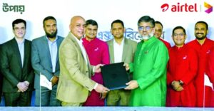 Sydul H Khandaker, Managing Director and CEO of upay and Shihab Ahmad, Chief Commercial Oficer of Robi Axiata Limited, exchanging document after signing an agreement on behalf of their respective organisations at a city hotel on Monday.Top officials from both sides were present.