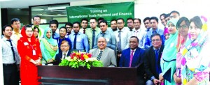Syed Waseque Md. Ali, Managing Director of First Security Islami Bank Ltd, poses with the participants of a training program on 'International Trade Payment and Finance'at the bank's Training Institute. Md. Ataur Rahman, Principal of Training Institute was also present in the programme.