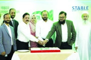 MominUdDowlah, Chairman and Managing Director of EON Group of Industries, cutting a cake marking the 21st founding anniversary of the company at its head office in the capital on Saturday. Senior executives of the company and other guests were present.