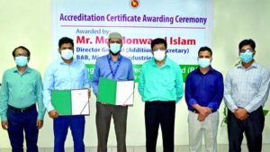 Md Monwarul Islam, Director General of Bangladesh Accreditation Board (BAB), poses for photo session at certificate handed over ceremony to officials of Summit Power Limited, the first IPP in Bangladesh to receive testing and calibration accreditations for its in-house labs.