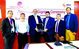 M. Shamsul Arefin, AMD of South Bangla Agriculture and Commerce (SBAC) Bank Limited and Md. Manzurul Karim, General Manager (Sales & Marketing) of Esquire Electronics Limited, exchanging document after signing an agreement at the bank's head office on Monday. Under the deal, SBAC Bank Credit Cardholders & employees will enjoy 0% EMI facility up to 12 months on purchases all products of the electronic company. Senior officials from both sides were present.