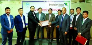 Mohammad Shamim Murshed, Head of Retail Banking Division of Premier Bank Limited and Khurrum Siddique, Managing Director of Simco Holdings Limited, exchanging document after signing an agreement on behalf of their respective organizations. Under the deal, both the company will promote Premier Home Loan to sell apartments among individual customers. M. Reazul Karim, Managing Director & CEO the Premier Bank Limited and Mozaffor Uddin Siddique, Chairman of Simco Holdings Limited were present.