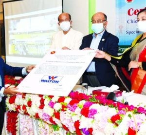 Engineer Golam Murshed, Managing Director of Walton Hi-Tech Industries Limited, receiving the trademark certificate from Industries Minister Nurul Majid Mahmud Humayun, at a function held on the occasion of 'World Intellection Property Day' at Officers' Club in the capital on Thursday.